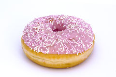 Pink doughnut isolated on white. Strawberry flavoured doughnut isolated on white Royalty Free Stock Photography