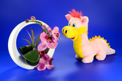 Pink dragon with a decorative vase of flowers Royalty Free Stock Image
