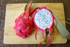 dragon fruit with half slice on the shopping board royalty free stock photos