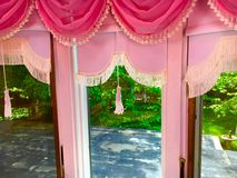 Pink Drapes. Fancy pink drapes on a window Stock Photography