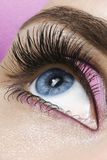 Pink Dream. Beautiful woman`s open eye. Pink eye-shadows royalty free stock photography