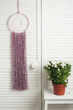 Pink dream catcher with flowers Stock Photo