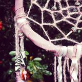 Pink dreamcatcher close up shot. Close up photo of pink dreamcatcher. Stylish beads on handmade item made by me. Weave Talisman to protect your dreams Stock Photo