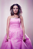 Pink dress. Young attractive girl in pink dress Stock Photo