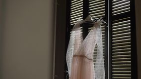 Pink dress in room. Indoors stock video footage