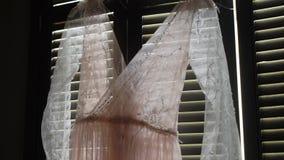 Pink dress in room. Indoors stock video