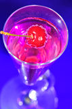 The Pink Drink. A unique pink drink in a fun glass with a cherry royalty free stock image