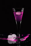 Pink drink. With ice cube in darkness royalty free stock photos