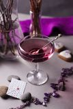 Pink drink in a glass in a romantic elegant setting - a women`s party or a romantic date.  royalty free stock image