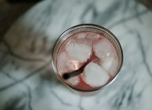 Pink drink on marble table stock photos