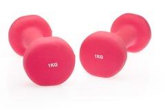 Pink dumbbells Stock Photos
