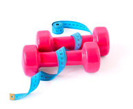 Pink dumbbells and blue meter Royalty Free Stock Photo