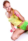 Pink dumbbells in the hands of women Royalty Free Stock Images