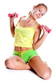 Pink dumbbells in the hands of women Stock Photo