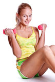 Pink dumbbells in the hands of women Royalty Free Stock Photography