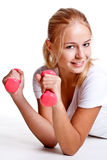 Pink dumbbells in the hands of women Stock Image