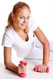 Pink dumbbells in the hands of women Stock Photo