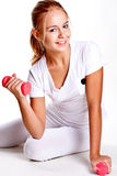 Pink dumbbells in the hands of women Royalty Free Stock Photos