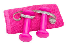 Pink dumbbells lying on a towel wrapped. Meter Stock Photos