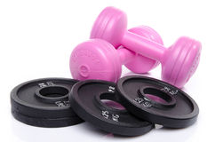 Pink dumbells with weights Stock Images