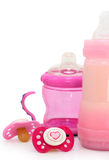 Pink dummies and bottles on white. Pink baby dummies and bottles on white royalty free stock images
