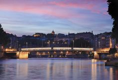 Pink dusk over Lyon. Beautiful pink dusk at the shore of the Saone river in Lyon. France stock image