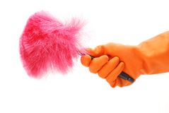 Pink Duster. Rubber gloved hand with duster stock images