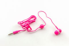 Pink earphones. Royalty Free Stock Images