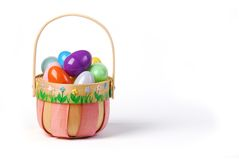 Pink Easter basket with colorful eggs. Pink decorated wooden basket full with large colourful eggs Stock Images