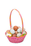 Pink Easter basket with colorful eggs Stock Image