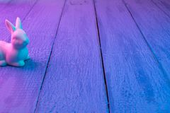 White Easter bunny on a blue wooden background stock photo