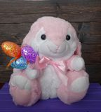 Pink Easter Bunny and eggs. With a wood background royalty free stock image