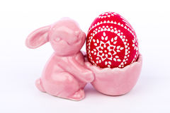 Pink Easter bunny eggshell with artistic painted Easter egg Royalty Free Stock Images