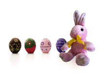 Pink Easter Bunny and painted eggs. Sat pink Easter Bunny and painted eggs Royalty Free Stock Photo