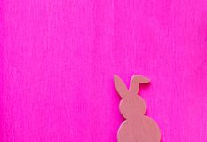 Pink Easter bunny on a pink background royalty free stock photo