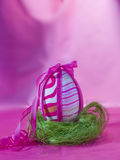Pink easter egg at the nest Royalty Free Stock Image