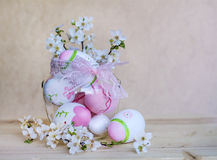Pink easter eggs  in glass vase with pink ribbon and cherry flowers Stock Photos