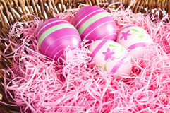 Pink easter eggs in a nest Stock Photography