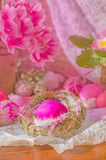 Pink easter eggs in nest and tulips. Background with easter eggs. Pink Easter eggs and nest on wodden background. Easter photo concept Royalty Free Stock Images