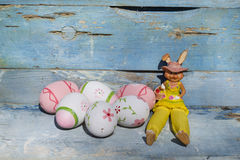 Pink easter eggs and rabbit  on a blue  wooden background Stock Image