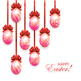 Pink Easter eggs with red bow Royalty Free Stock Photo