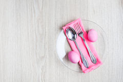Pink Easter eggs on white table Royalty Free Stock Photos