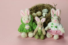 Pink Easter Family. Easter decoration with Easter bunny family and natural bird's nest with eggs stock image