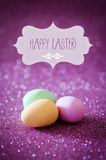 Pink easter greetings. Happy easter greeting card, pink glitter and pastel easter eggs Royalty Free Stock Photos
