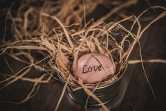 Pink Easter Love egg in basket stock images