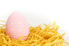 Pink egg in nest Stock Image
