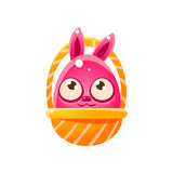 Pink Egg Shaped Easter Bunny In Basket Stock Photo