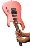 Pink electric guitar in hads Stock Photo