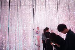 Pink electric lights. exhibition by teamLab in the Mori Digital Art Museum. guy in pink shorts. Tokyo / Japan - Sept 12 2018: mori digital art museum, Odaiba stock image
