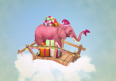 Pink elephant with Christmas boxes. Royalty Free Stock Photo